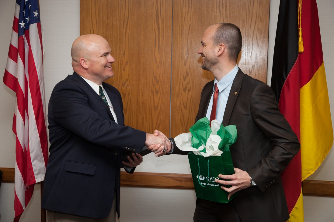 Dr. Ridpath and Dr. Strobel exchange gifts and greetings